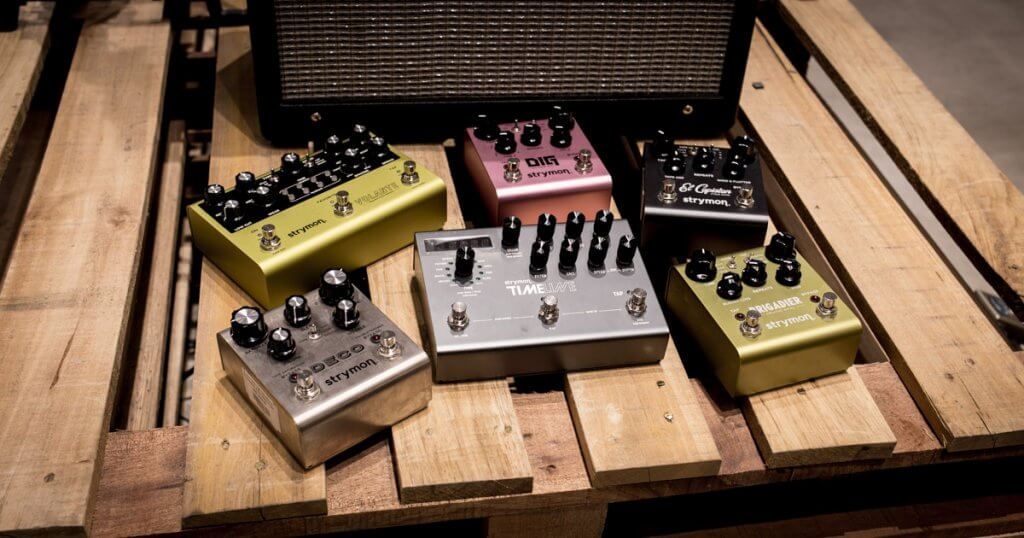Complete collection of Strymon Delay pedals on a display rack
