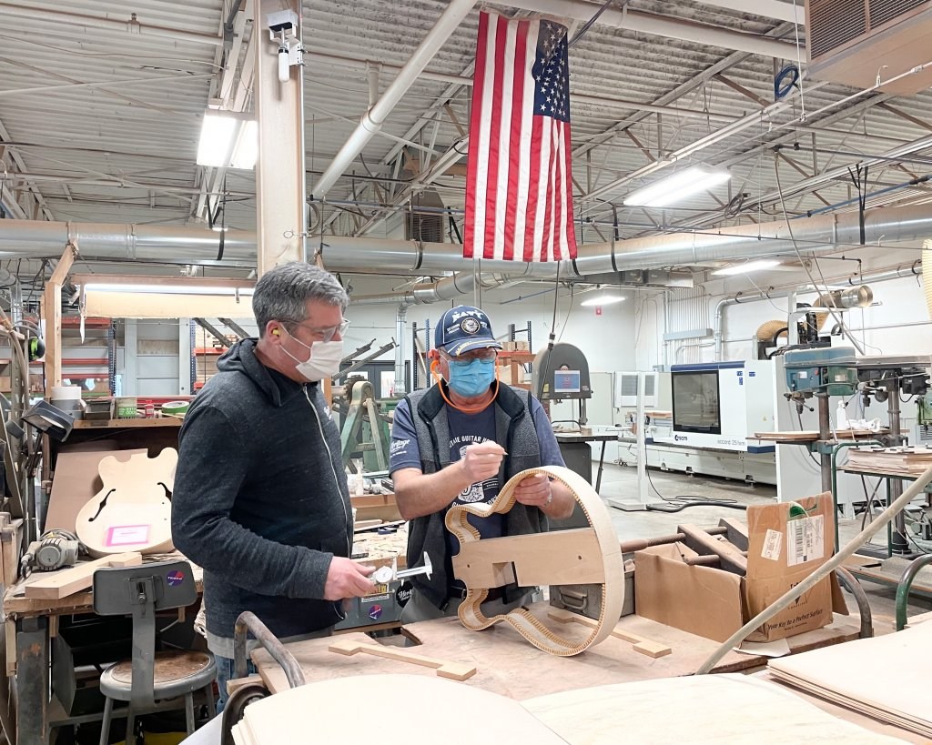 Heritage Guitars luthiers work on a semi-hollow guitar in Kalamazoo, Michigan!
