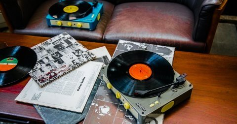 Gadhouse Brad Turntable with Vinyl and Vinyl Sleeves on a Coffee Table