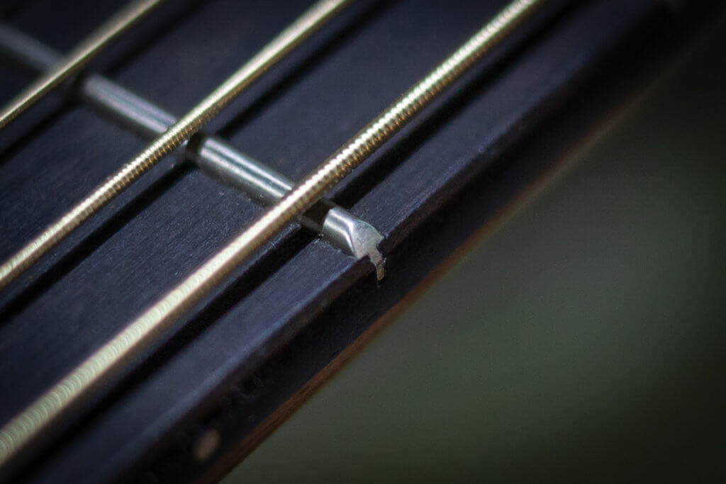 Shrinking frets on an acoustic guitar