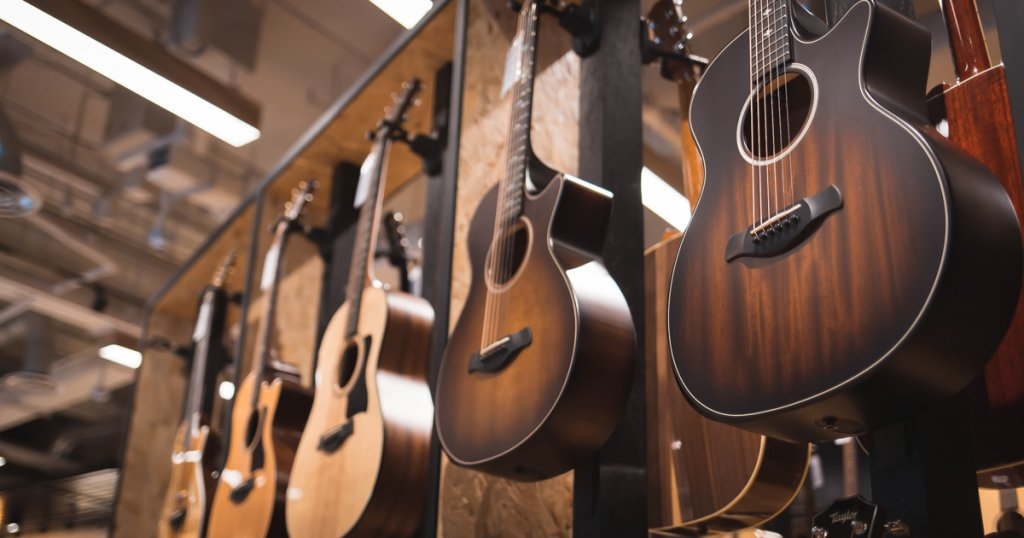 Taylor acoustic guitars with solid wood top at Swee Lee Star Vsita