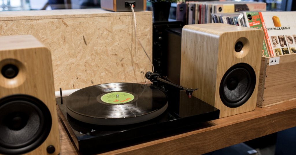 Vinyl Turntable and Audio Speakers in A Music Store