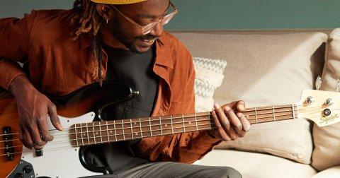 man playing the bass guitar